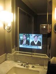 Bathroom Mirror With Tv by Vanishing Tv Mirror Above Fireplace Visible From Kitchen