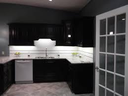 chocolate brown kitchen cabinets and white backsplash design
