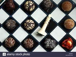 Fancy Chess Boards Fancy Chocolates On A Chess Board With King Resigned Stock Photo