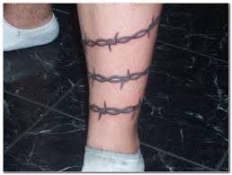 barbed wire tattoo on leg