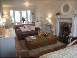dining table in front of fireplace narrow living room layout with fireplace l shaped long sofa with