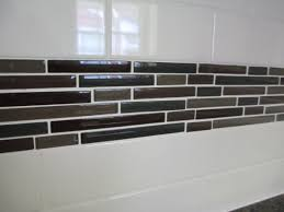 backsplash ideas glass tile accents with white subway tile red