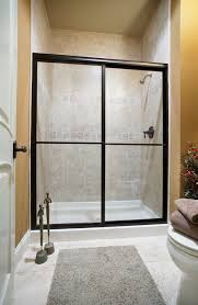 The Shower Door Doctor Deluxe Bypass Shower Door Featuring Clear Glass Rubbed
