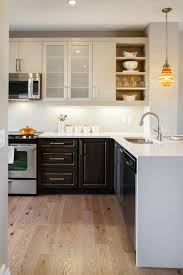 stone countertops two toned kitchen cabinets lighting flooring