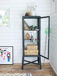an ikea dark grey fabrikör glass door cabinet with a dioder 4