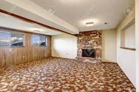 empty living room with brick fireplace wooden plank paneled