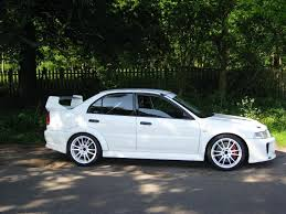 mitsubishi sports car white white evo 5 with white alloys pictures please mitsubishi lancer