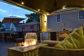 arched veranda on roof deck with built in bar kegerator firepit