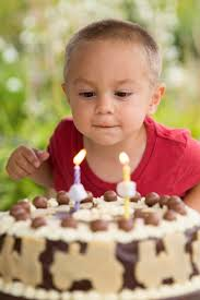 boy blowing out candles free stock photo public domain pictures
