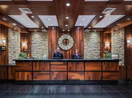 Staten Glass Corner Desk by Hotels Near Newark Liberty International Ewr