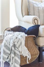 baskets for home decor 11 ways to use baskets for storage and decor in your home kelley nan