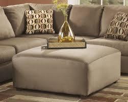 Cowan Ottoman Mocha by Ashley Furniture