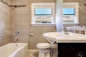 modern bathroom interior with window and tile wall trim empty