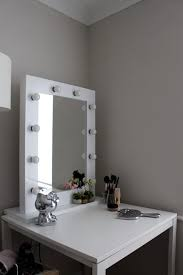 bathroom fascinating mirror with lights around it for home