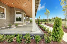 covered porch large farm country house with long covered porch and green