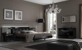 minimalist bedroom design with grey wall paint completed with dark