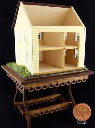 miniature landscaped dollhouse for a dollhouse on display table
