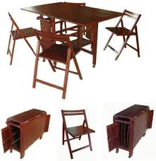 Captivating Hideaway Dining Table And Chairs  With Additional - Dining room table with hidden chairs