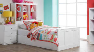 white single bed featured cube storage headboard with colorful