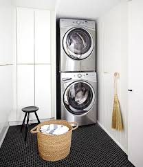 laundry room floor cabinets laundry room with black and white tiles design ideas