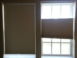 window lovely tan levolor cellular shades covering the glass