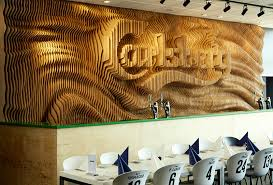 wood pieces for walls designers create a wall for carlsberg from 160 laser cut pieces of
