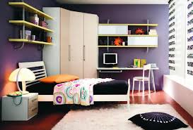 Woman Standing In A Bedroom With Ikea Bed Armchair Mirror Drawers - Ikea boys bedroom ideas