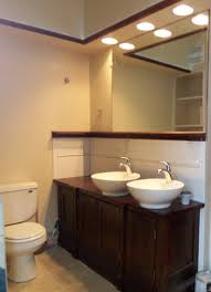 recessed lighting over bathroom sink interiordesignew com
