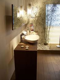 amazing zen bathroom with bamboo plants and vessel sink also