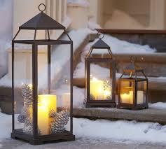 porch decorating ideas metal lanterns pinecones