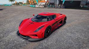 red koenigsegg regera koenigsegg regara red with carbon hood stripe paint booth