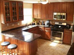 what color granite goes with brown cabinets brown granite countertops pictures cost pros and cons