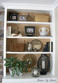 decorating a bookshelf create a bookcase piled high with personality and style shelves