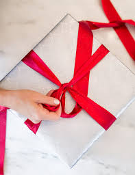 How To Wrap Gifts - a perfectly wrapped present how to wrap a gift and tie a tiffany bow