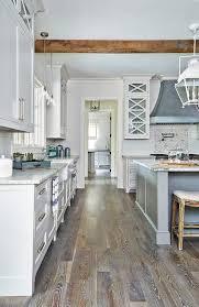 posting for the floors rustic kitchen boasts a zinc hood mounted against above a wolf range white glazed subway backsplash tiles framing mosaic