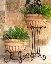 home design and decor wrought iron planters tall and short