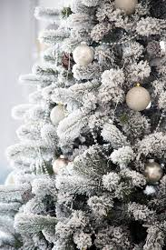 a remarkable gift of christmas a flocked tree shabbyfufu