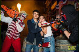saw at halloween horror nights bella thorne u0026 tyler posey couple up at halloween horror nights