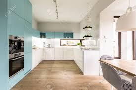 modern white kitchen cabinets wood floor blue and white cabinets in modern kitchen interior with wooden
