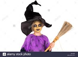 with face paint and halloween witch costume isolated in white