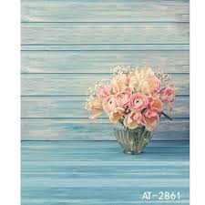 backdrop background light turquoise wooden planks with a vase of
