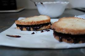coconut macaroon sandwich hearts with chocolate coffee filling