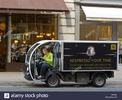 electric company truck paris france electric delivery truck van on street nespresso