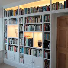 white painted wall shelving and cupboard by freebird fitted