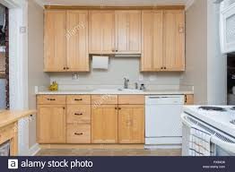 cabinets in small kitchen clean light wood cabinets in small kitchen space stock