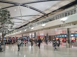 Michigan Business Travel images Travelers walk through detroit metro wayne county airport terminal