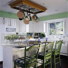 Kitchen Island With Hanging Pot Rack Kitchen With Mirrored Backsplash To Create The Illusion Of Space