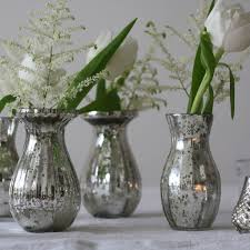 dainty mercury silver vases make lovely groupings on wedding