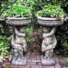 large metal garden planters exhort me
