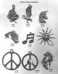 large pewter pendants clef symbol unicorn sun eagle peace sign